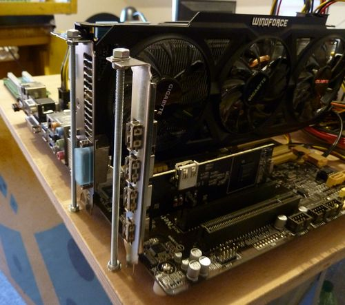 Fixing the PCI cards on the mainboard with threaded rods