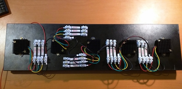 Flasher LEDs mounted on the wooden board and wired with the series resistors